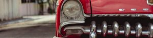 vintage-red-car-park-on-the-street-Headlight